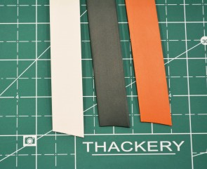 "Red, Black or White Heat Shrink Tubing - choose color - sold by the foot - 1/2"" and shrinks to 1/4"" (2:1 ratio)"
